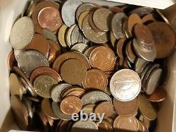 A box of coins from around the world old and new. 200+ coins
